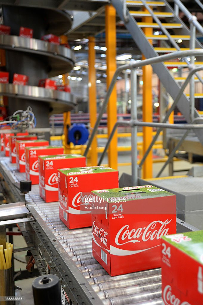 Boxes of Coca-Cola Classic move along a conveyor at a Coca-Cola Amatil Ltd. production facility in Melbourne, Australia, on Tuesday, Aug. 19, 2014. Coca-Cola Amatil flagged a second consecutive drop in full-year earnings amid weak consumer confidence and rising costs in Indonesia. Photographer: Carla Gottgens/Bloomberg via Getty Images