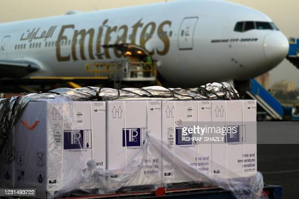 Boxes of coronavirus vaccines are stacked on the tarmac after the first batch arrived at Khartoum airport in the Sudanese capital in an Emirates...