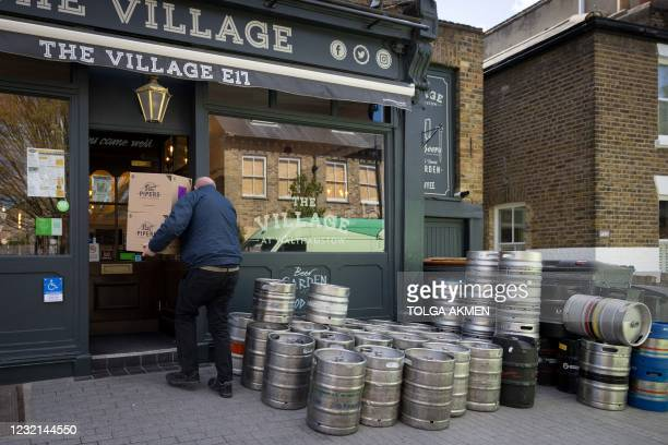Boxes of crisps are delivered to The Village Pub in Walthamstow, northeast London on April 6 as it restocks ahead of partial re-opening on April 12...