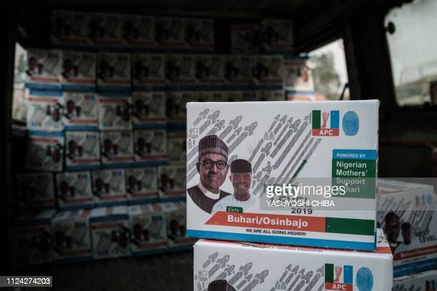 Boxes of food donation bearing the faces of Nigeria's incumbent President Mohammadu Buhari and Vice President Yemi Osinbajo are seen in a van in...