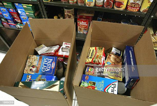 Boxes of food items for clients are seen at the Maine Township Food Pantry May 14, 2003 in Park Ridge, Illinois. Pantry coordinator Carol Langan said...