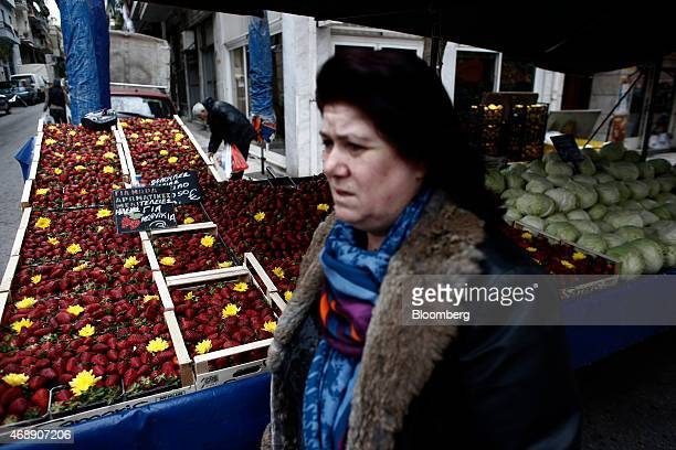 Boxes of fresh strawberries sit for sale beside euro price signs at a street market stall in Athens Greece on Wednesday April 8 2015 Russian...