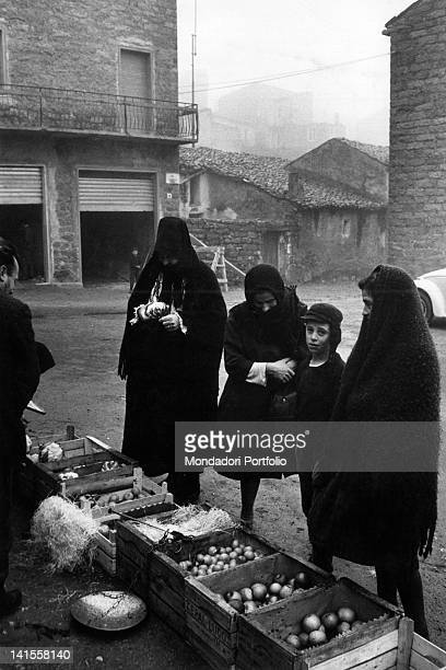 Boxes of fruit and vegetables on sale in a square in Ollolai Ollollai 1967