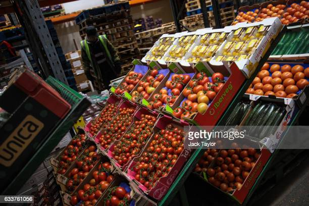 Boxes of fruits and vegetables are packaged for sale at the New Covent Garden fruit and vegetable wholesale market Nine Elms on February 4 2017 in...
