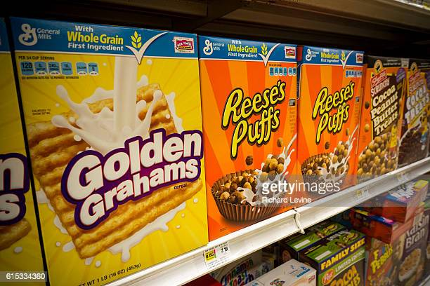 Boxes of General Mills breakfast cereals including Golden Grahams and Reese' Puffs displayed on supermarket shelves in New York on Tuesday June 23...