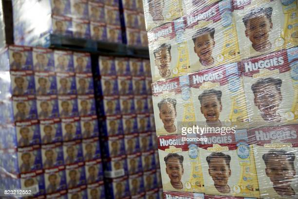 Boxes of Huggies brand diapers sit stacked in the warehouse of the KimberlyClark Corp manufacturing facility in Paris Texas US on Tuesday Oct 27 2015...