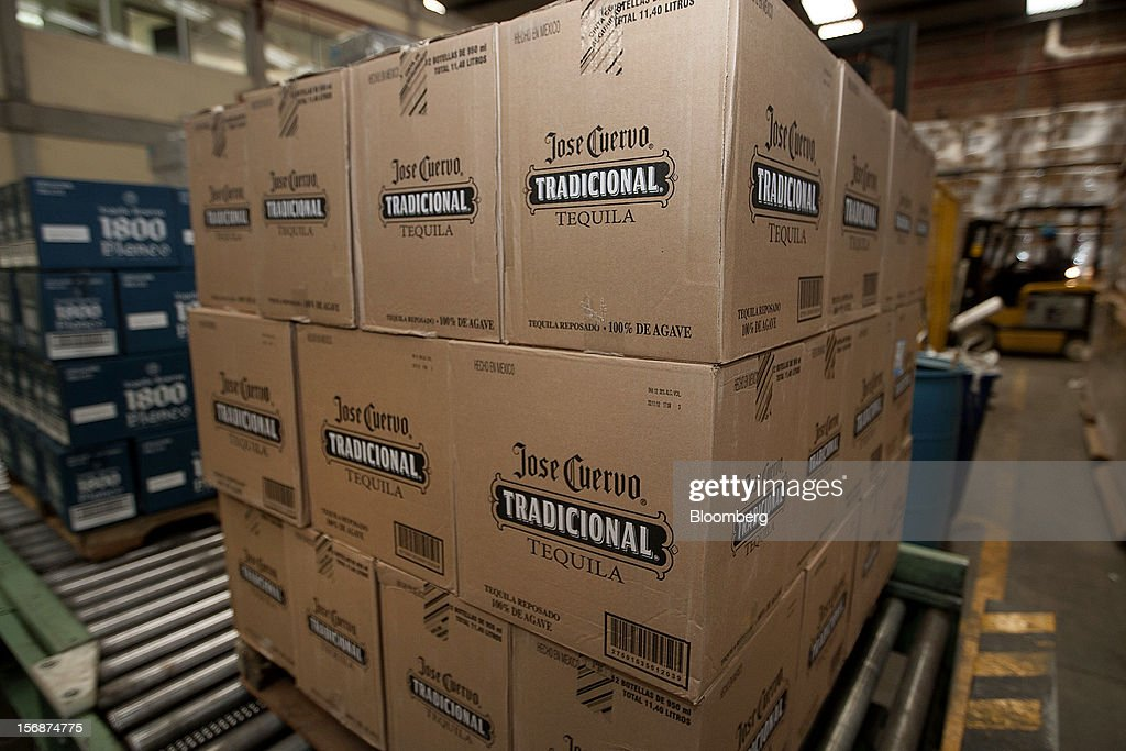 Boxes of Jose Cuervo Tradicional sit stacked before shipment at the Tequila Cuervo La Rojena S.A. de C.V. bottling factory in Guadalajara, Mexico, on Thursday, Nov. 22 2012. There are more than 200 types of agave in Mexico, but use of the blue agave plant was made compulsory in the last century to the issuance of the Official Mexican Standard for Tequila production. Photographer: Susana Gonzalez/Bloomberg via Getty Images