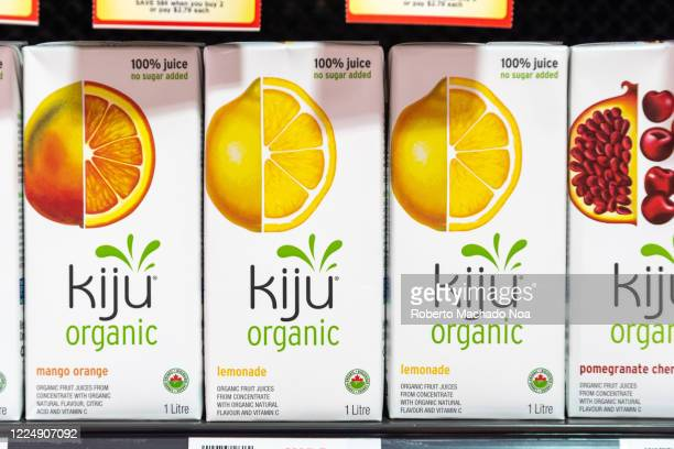 Boxes of Kiju branded organic juice. There are flavors of Mango, Lemonade and Pomegranate. The boxes are seen on a store shelf.