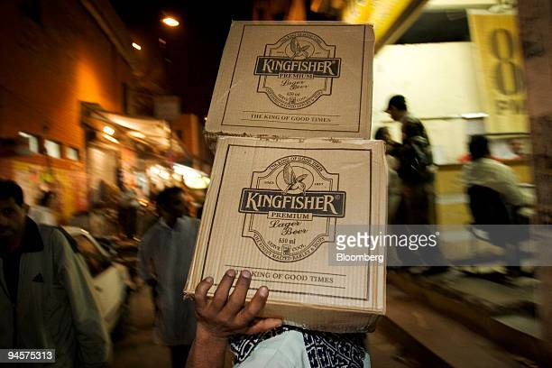 Boxes of Kingfisher Beer made by United Breweries Ltd are delivered to a liquor store in New Delhi India March 18 2007
