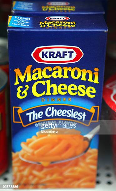 Boxes of Kraft Foods Inc Macaroni Cheese sit on a shelf in a grocery store in Glenview Illinois US on Tuesday Jan 19 2010 Cadbury Plc agreed to an...