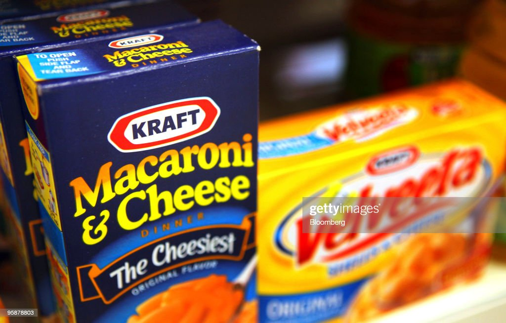 Boxes of Kraft Foods Inc. Velveeta Shells & Cheese and Macaroni & Cheese sit on a shelf in a convenience store in Des Plaines, Illinois, U.S., on Tuesday, Jan. 19, 2010. Cadbury Plc agreed to an improved 11.9 billion-pound ($19.7 billion) offer from Kraft Foods Inc., ending more than four months of resistance and creating the world's largest confectioner. Photographer: Tim Boyle/Bloomberg via Getty Images News