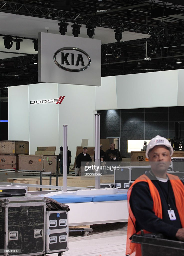 Boxes of materials sit near the Kia Motors Corp. and Chrylser Group LLC's Dodge exhibits during an advance tour of the North American International Auto Show (NAIAS) at Cobo Hall in Detroit, Michigan, U.S., on Thursday, Jan. 10, 2013. More than 23,000 attendees representing almost 2,000 companies are expected to attend the industry preview for NAIAS on Jan. 16-17. The general public can attend the show from Jan. 19-27. Photographer: Jeff Kowalsky/Bloomberg via Getty Images