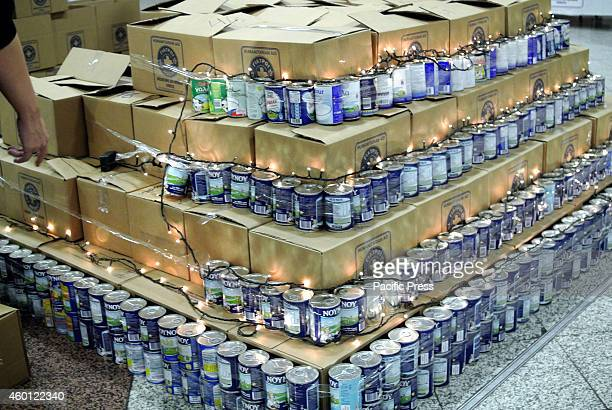 Boxes of milk are stacked on each other in order to make a treeThe Greek department of 'Medecins Du Monde' organized an event in Syntagma square to...