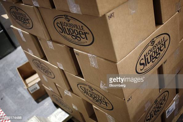 Boxes of miniature novelty Louisville Slugger baseball bats sit