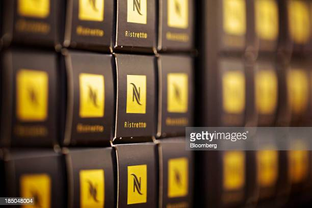 Boxes of Nespresso singleserve coffee capsules sit displayed for sale inside the Nestle SA store next to the company's headquarters in Vevey...