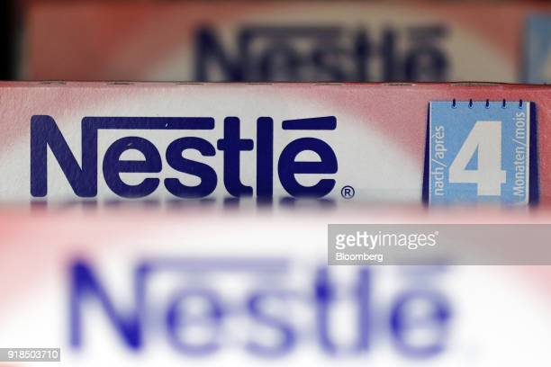 Boxes of Nestle infant food stand on display in a shop at the Nestle SA headquarters in Vevey Switzerland on Thursday Feb 15 2018 Since taking over...