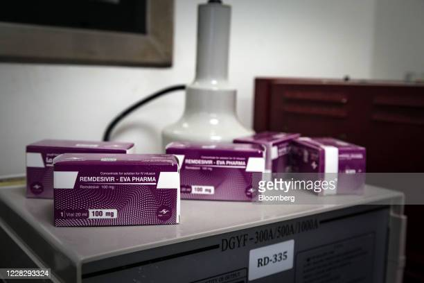 Boxes of Remdisivir anti-viral drug sit on display at the Eva Pharma facility used for its manufacture in Cairo, Egypt, on Aug 2020. One of the early...