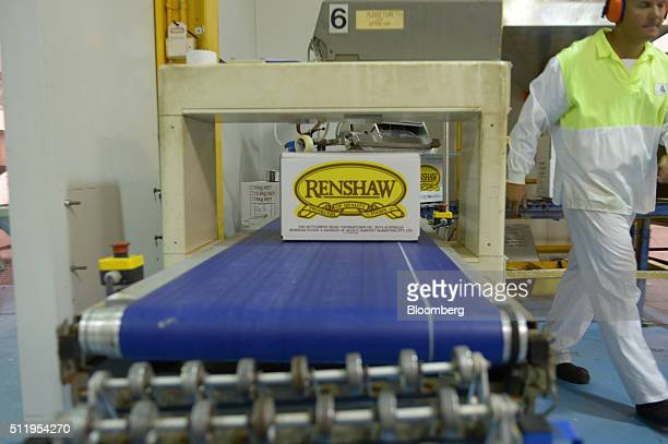 Boxes of Renshaw brand finely chopped peanuts move along a conveyor belt at a Select Harvests Ltd processing facility in Melbourne Australia on...