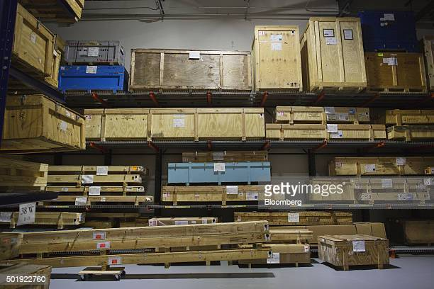 Boxes of replacement parts for jets sit on shelves in the Dassault Aviation SA Falcon Jet parts distribution center at Teterboro Airport in Teterboro...