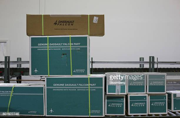 Boxes of replacement parts for jets sit stacked in the Dassault Aviation SA Falcon Jet parts distribution center at Teterboro Airport in Teterboro...