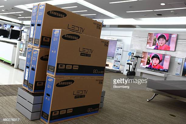 Boxes of Samsung Electronics Co lightemitting diode televisions sit at the company's digital plaza store in Seoul South Korea On Friday Jan 4 2014...