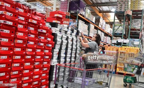 Boxes of shoes are stacked high for shoppers at a Costco store in Alhambra California on August 19 2019 American consumers spent far more than...
