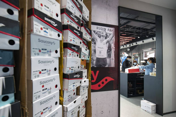 CHN: Inside A Saucony Shoe Store And Domestic Retail in Shanghai As China's Modest Growth Target Signals Policy Shift From World