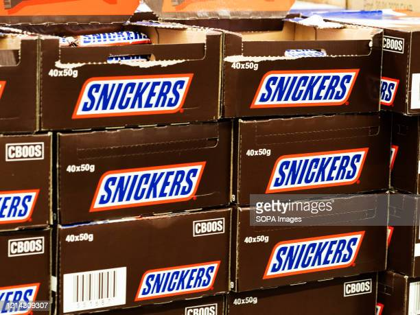 Boxes of Snickers Chocolate Bars seen displayed on a supermarket store.