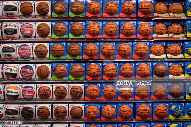 Boxes of Spalding basketballs branded with the National Basketball Association logo and Wilson basketballs branded with the National Collegiate...