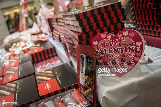 Boxes of specialty chocolates are seen on display at a department store on February 12 2015 in Tokyo Japan In Japan Valentine's day is celebrated...