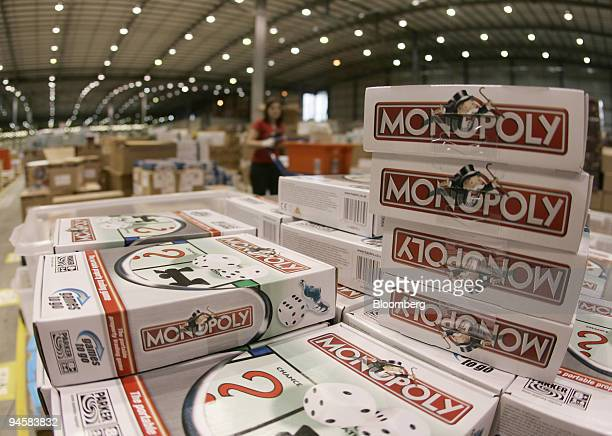 Boxes of the Monopoly board game sit on a shelf in the Amazon distribution centre near Milton Keynes, UK, Friday, November 17, 2006.