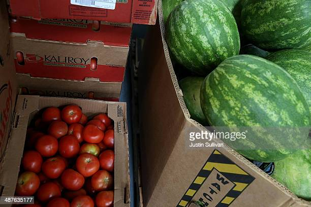 Boxes of tomatoes and watermelons sit in the warehouse at the SFMarin Food Bank on May 1 2014 in San Francisco California Food banks are bracing for...