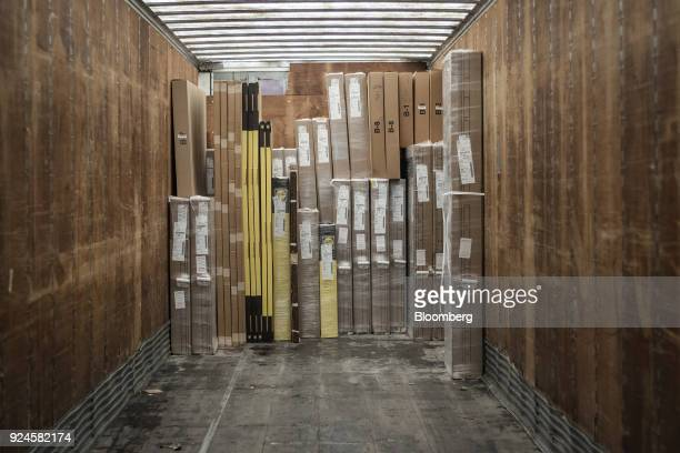 Boxes of window and door frames sit in the trailer of a semitrailer truck at the Pella Corp manufacturing facility in Pella Iowa US on Thursday Feb...