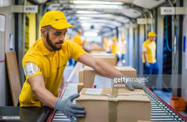 boxes on conveyer belt - sending stock photos and pictures