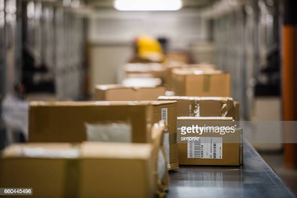 boxes on conveyer belt - sending stock pictures, royalty-free photos & images