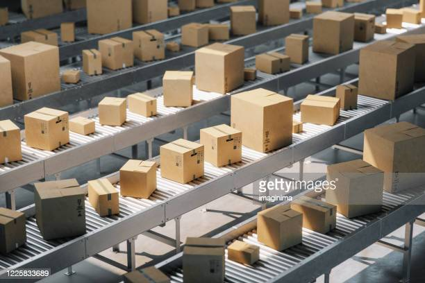boxes on conveyor belt - packaging stock pictures, royalty-free photos & images
