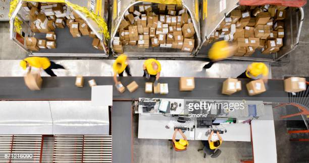 boxes on conveyor belt - heavy industry stock photos and pictures