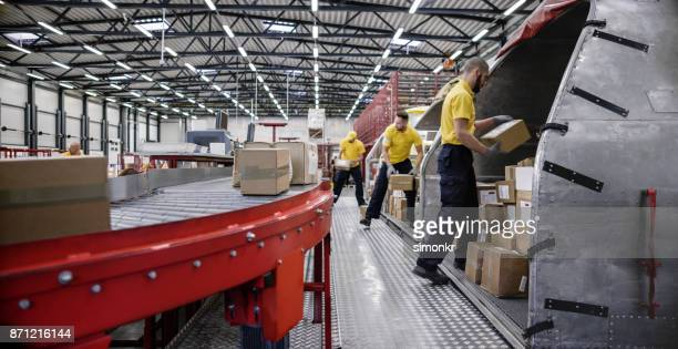 boxes on conveyor belt - logistics stock pictures, royalty-free photos & images