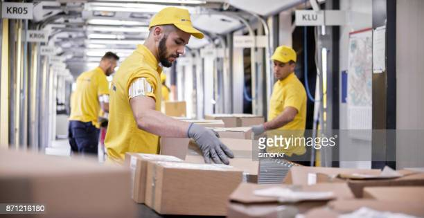 boxes on conveyor belt - beige glove stock photos and pictures