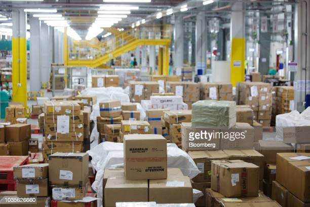 Employee scan a packages at the Amazon Inc fulfillment center in Bengaluru India on Tuesday Sept 18 2018 India with its more than 13 billion people...