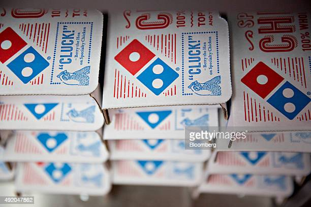 Boxes sit stacked at a Domino's Pizza Inc restaurant in Rantoul Illinois US on Thursday Oct 8 2015 The pizza chain has been trying to draw more...