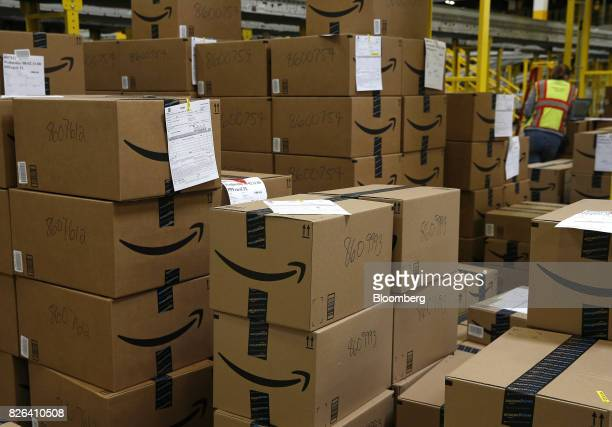 Boxes sit stacked at the Amazoncom fulfillment center in Kenosha Wisconsin US on Tuesday Aug 1 2017 Amazoncom Inc held a giant job fair at nearly a...