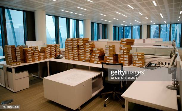 Boxes sits on desks in the consular section during a press preview of the new United States Embassy building in central London on December 13 2017...