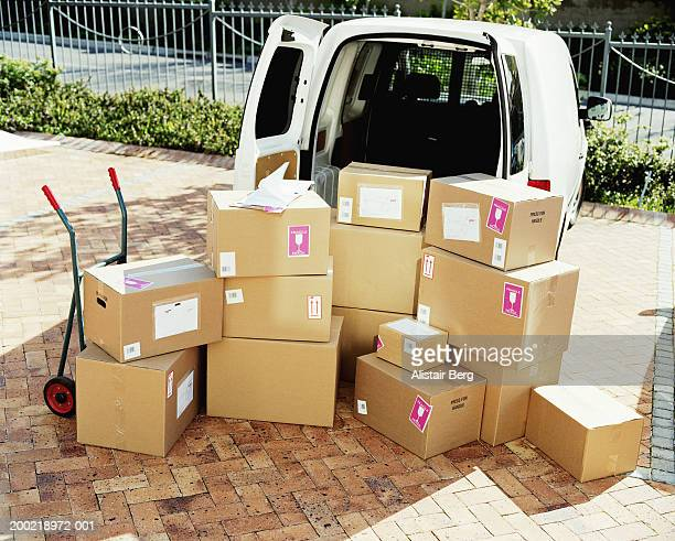 Boxes stacked by open van