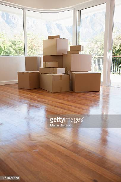 Boxes stacked in living room of new house