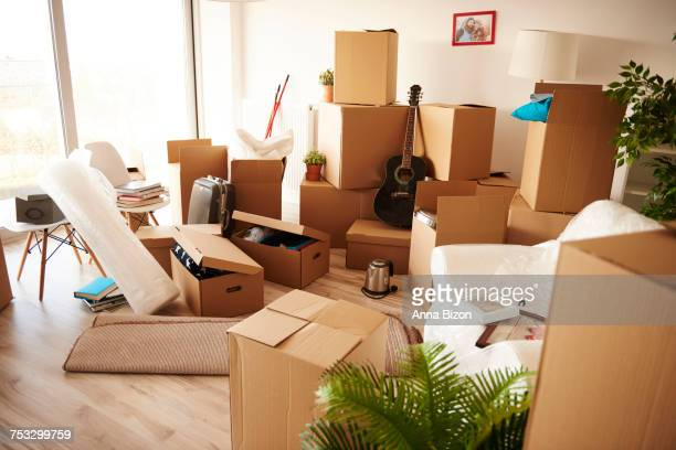 Boxes stacked on wooden floor of new house. Debica, Poland