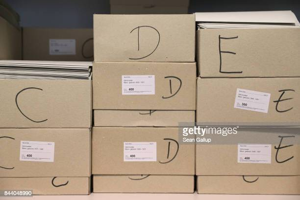 Boxes that contain mailin ballots lie on a shelf at at a local voting bureau for early voting in German federal elections on September 8 2017 in...