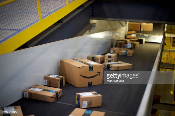 Boxes travel on conveyor belts at the Amazon Fulfillment Center on August 1 2017 in Robbinsville New Jersey The more than 1 million square feet...