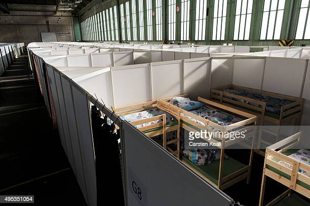 Boxes with beds for migrants set up at an refugee shelter for migrants seeking asylum in Germany inside Hangar 3 at former Tempelhof Airport on...