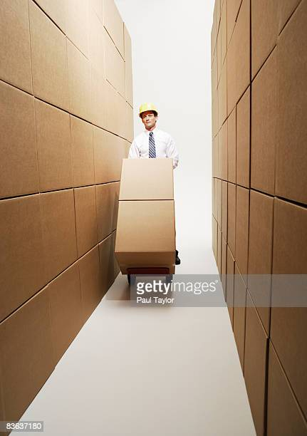 Boxes with man and dolly